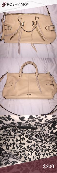 NWOT Rebecca Minkoff Large Moto Satchel NWOT Rebecca Minkoff Large Moto Satchel. The hardware, leather, and lining are all in perfect condition. The color is beige called Biscuit. The only wear is a little bit of blue color transfer from something it was touching while in my closet? It's barely noticeable (photo 7&8). Also, it comes with the strap as shown in photos and extra leather tassels.                     ✨OFFERS WELCOME✨ Rebecca Minkoff Bags Satchels
