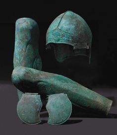 Chalcidian helmet and a pair of greaves, bronze, 5th/4th century BC
