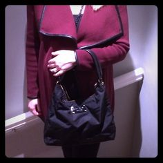 Kate Spade Black Nylon Shoulder Bag Great condition.  Very easy to clean.  Black polka dot lining.  Zip pocket and small inside pockets.  Leather shoulder strap and zip closure. kate spade Bags Shoulder Bags