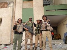 Matthew VanDyke with Libya rebels in District Two during the Battle of Sirte in the Libya War