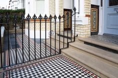 Victorian style black and white tiled pathway, in stylish London front garden.