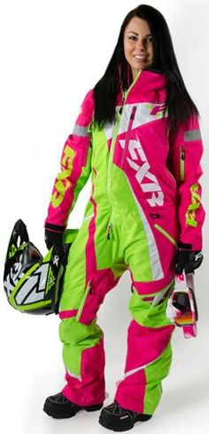 Lydia is wearing an FXR lime green,  hot pink,  & white snowmobile fullsuit.