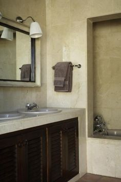no backsplash - monotone wall tile, darker tile for floor