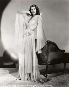 Rita Hayworth makes us want to live in a dramatically long robe like this! Let's bring this back for spring! http://www.adoreme.com #AdoreMeNYFW