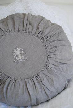 grey linen circular cushion