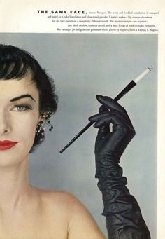 Vogue, 1952 I love the cigarette holders in old movies!