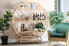 This eye-catching shelving unit is handmade from a natural, sustainable rattan material. The huge natural cane frame holds three sturdy shelves. Ideal for books, photos, ornaments and anything else you want on display! The four thick cane feet keep the Etagere firmly on the ground – and it is also available in a smaller size in case you think this one is too big. #wickerfurniture #rattanfurniture #retrofurniture #bohemianstyle Natural Furniture, Rattan Furniture, Retro Furniture, Bohemian Style, Boho Chic, Shelving, Display, Eye, Ornaments