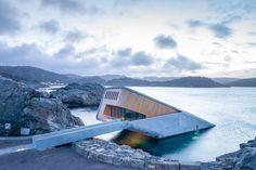 Europe's first underwater restaurant has recently opened in Norway. The restaurant offers visitors the chance to eat seafood while looking out at life under the ocean. Underwater Hotel, Underwater Restaurant, Open Architecture, Residential Architecture, Scandinavian Architecture, Concrete Architecture, Sustainable Architecture, Small Places, Great Places