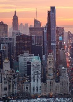 NYC photography. Manhattan photography.. South Central Park in the foreground, looking South at sunset.