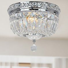 Add a touch of classic elegance to your dining room or entryway with this flushmount light fixture made by Elisa. Crafted from genuine crystal glass in a dazzling chrome finished frame to add sophisti