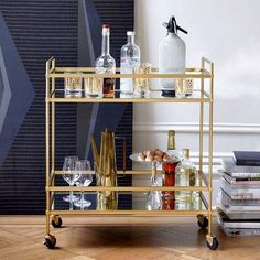 Cocktail station. Inspired by Deco design, the glamorous Terrace Bar Cart offers an airy surface for your favorite spirits. Fitted with four wheels, it's a flexible piece that can move with the party. #bar #party #booze #boozecart #modern #bardecor