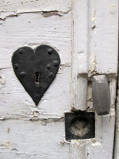 white rustic heart lock