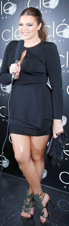 Who made  Khloe Kardashian's black slit long sleeve peplum dress and green leaf sandals that she wore in  in Dubai on October 10, 2014