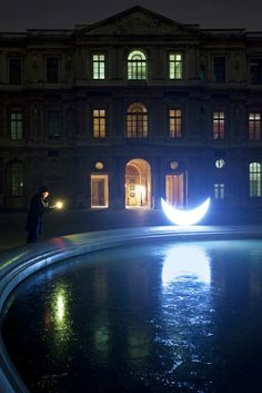 Leonid Tishkov: Private Moon_Journey to Paris Louvre at night The moon has laid a silvery trail across the celestial ice.I'll give her a star found in the yard among rubbish,leaves and discarded memories.