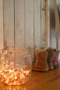 don't stash those holiday lights ... put lights in oversized glass vessel for an entryway nightlight ... great idea!