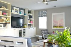 She took this modern traditional family room from basic to fun and comfortable with just a few smart updates