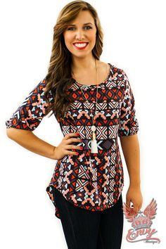 Out Of Line Top - Aztec Tribal is back this season and we love this little top's version of it! It's edgy print features hot colors of peach, mint, orange and black. It's quarter length sleeves and lightweight material make this top a perfect transition piece for the fall. Wear it with a pair of Envy skinny jeans and accessories for a complete autumn look!  | available at http://www.envyboutique.us/shop/line-top/ |  #Envy #Boutique #fashion #fashiontrends