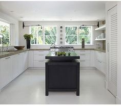 kitchens-black-white-countertops-double-sinks-kitchen-islands-light-airy-open-shelving