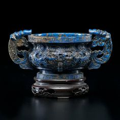 Chinese, early 20th century. A lapis lazuli incense burner carved in the form of an archaic ritual bronze with scroll work design and beast form handles; ht. without stand 2.25 in.