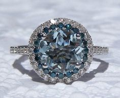 Holy CRAP this is stunning. Aquamarine Engagement Ring, White Gold Diamond Halo Engagement Ring with Blue Diamonds, Blue Diamond Engagement Ring