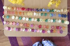 paper leis tutorial by xoelle, via Flickr    A cute craft for a birthday xD if someone had energy to make loads of them. LOL!