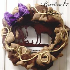 Brown & burlap western wreath! This wreath is decorated with a metal piece of a praying cowboy. It also has real rope around it and a
