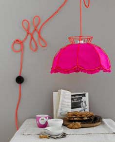 neon pink statement lamp // love the cord design on the wall