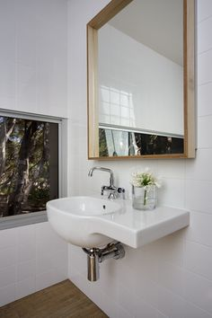 Custom-built mirrors have been used in the bathrooms
