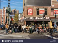Busy street corner of West 34th Street and Ninth Avenue in Hell's Kitchen on Ninth Ave. in New York Stock Photo