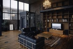 Manly : brick wall, big dark wood shelving, black framed windows, hard floors & black leather couches (+ elevator lazyness)