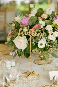 Pink and gold wedding table decor: Want a subtle gold and pink palette? Use cream-colored linens with gold pattern accents, blush floral centerpieces, and wooden table numbers painted in a light matte gold. The effect is a blushing glow, rather than an in-your-face punch of pink and sparkle.