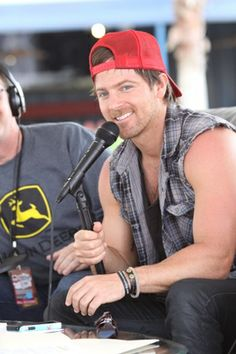 Baseball hat. Good voice. Muscles. Cowboy. Smile. Need I say more?
