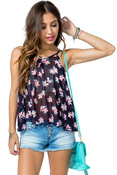 Knock 'em out this summer! A sweet chiffon top featuring a ditsy petal print and a scoop neck. Spaghetti straps. Keyhole back with a button loop closure. Marrow finished hem. Swing silhouette.