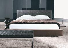 Bedroom in sleek, warm tones with the Minotti Bartlett bed & Mongé bench _