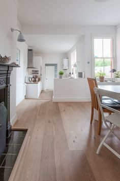dining to kitchen, distinctly beautiful | Bonnie & Russell's Scandi-Style Victorian