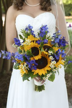 Beautiful sunflowers with the something blue! Replace the little daisies with baby's breath!