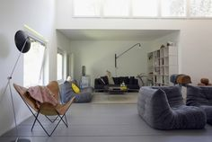 I love everything about this room: butterfly chair, grey sofas, lamp and the yellow pillow