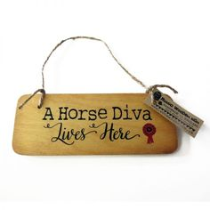 A horse diva lives here wooden sign