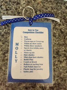 Bag tag/checklists for my daughter's cheer team. Made using paper, 4x6 thermal laminator pouches, key rings and ribbon.
