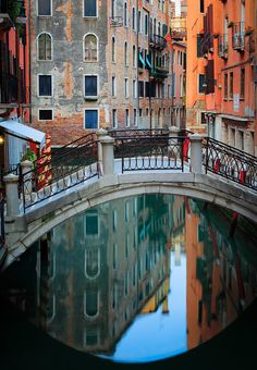 ✮ One of many foot bridges in Venice, reflecting in a small canal