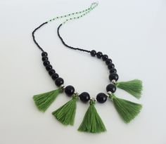 Necklace with small black beads and green beads with green fringes. It measures 68cm open. by MontradaCarolina on Etsy