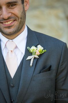 Groom in charcoal suit with vest. Blush tie. Napa Valley Wedding. Blush and Ivory Freesia Garden Rose boutonniere