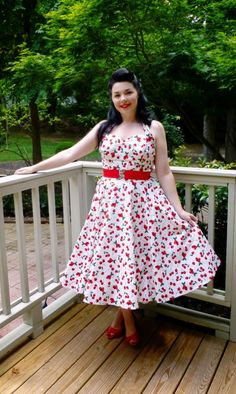 http://www.vivienofholloway.com/ The Beautiful Lisa Rowe wearing our 1950s Halterneck Circle Dress in cream cherry cotton! #VivienofHolloway #VivienHolloway #VoH #Vintagereproduction #madeinlondon #1950sstyle #1950sfashion #1950s #1950sglamour #pinupgirl #pinup #rockabilly #rockabillygirl #rockabillyclothing #pinupfashion #1950sCherryDress