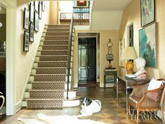A David Hicks-designed carpet leads the eye up the stairwell, while a white cowskin rug rests atop handpainted floors.