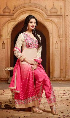 Cream and Pink Embroidered Georgette Pant Style Suit Stun the crowd in this cream and pink embroidered georgette pant style suit. This wonderful attire is showing some brilliant embroidery done with resham work.  #GeorgettePantStyleSuit #LatestDesignerSuits