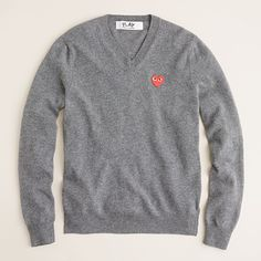 PLAY Comme des Garcons V-neck in grey. J. Crew men's dept.    This sweater is a must have in both colors!!  $350.00