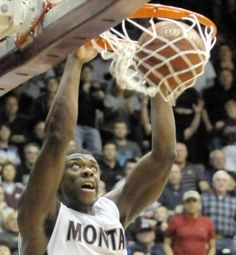 TOM BAUER/Missoulian  Montana senior Art Steward dunks the ball during the Grizzlies' Big Sky Conference championship game against Weber State at Dahlberg Arena. Read more: http://missoulian.com/college/griz/team-chemistry-key-to-record-setting-griz-season/article_a4dc1010-763c-11e1-9f3c-0019bb2963f4.html#ixzz1q8rSA3F0
