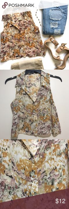 NWOT Floral Print Button Down Crop Top This adorable sleeveless blouse features an all over floral print, button closures in front and crop top silhouette. Unlined. NWOT, 100% polyester. Tops