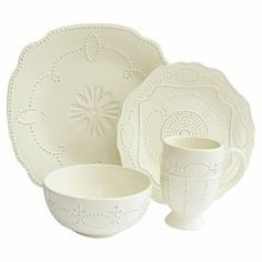 "Sixteen-piece scalloped earthenware dinnerware set with a textured geometric motif.  Product: 4 Dinner plates 4 Salad plates  4 Bowls  4 MugsConstruction Material: EarthenwareColor: CreamDimensions: 12"" W x 12"" D each (dinner plate)"