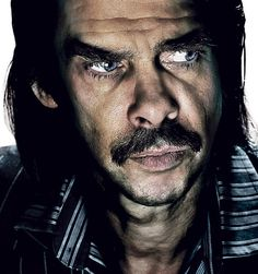 GLORIOUS photograph of the Nick Cave moustache. So brooding. So beautiful.